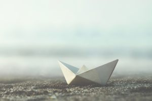 Little,Paper,Boat,On,The,Sand